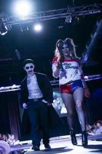 Models dressed as Harley Quinn and the Joker walk the runway