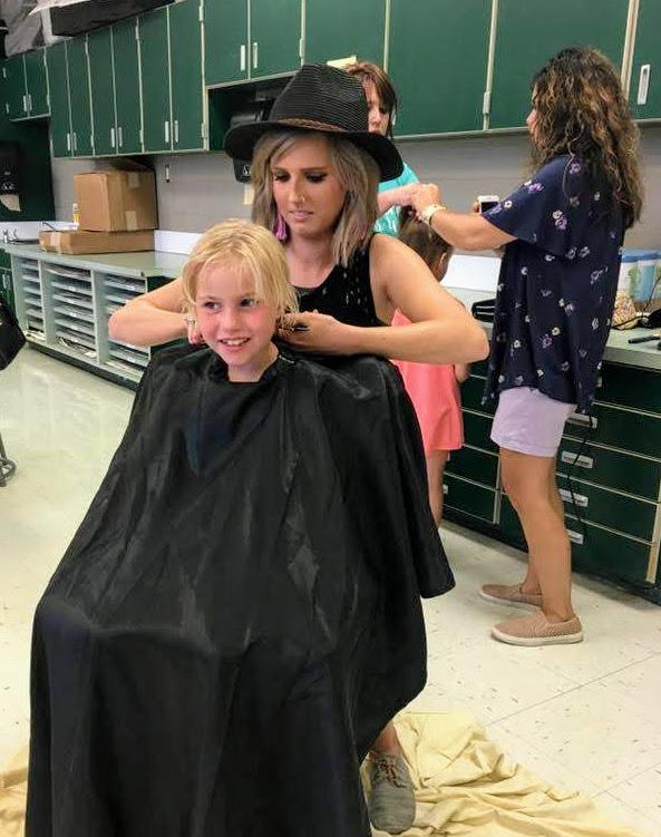savannah cutting a child's hair